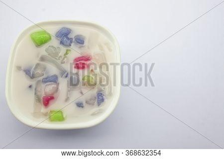 Thai Dessert Rainbow Glutinous Rice Balls Or Bua Loi In A White Cup.