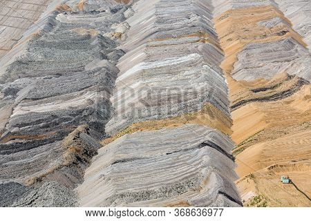 Wide Open Pit Landscape With Deposits Of Unused Soil After Digging In Hambach Mine Germany