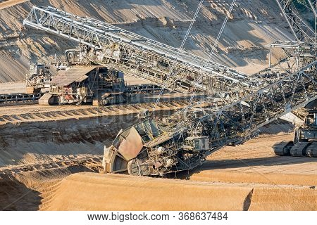 Brown Coal Open Pit Landscape With Enormous Digging Excavator In Hambach Mine Germany, This Machine