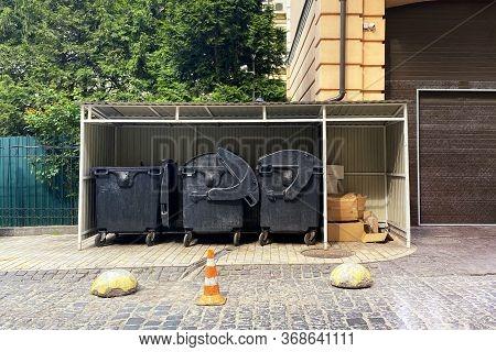 Dustbins Being Full With Garbage. Garbage Is Pile Lots Dump. Garbage Bins In Sunny City. Cardboard I