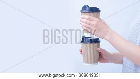 Woman Holding Two Cardboard Cups Of Coffee On Gray Background, Take Away Concept, Space For Text
