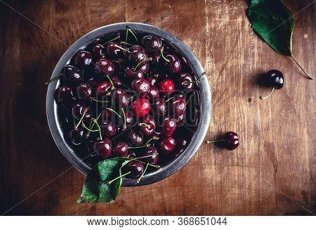 Fresh Cherry Food Closeup. Healthy Food. Vegetarian Food. Nutritious Food. Fresh Cherry Fruit On Woo