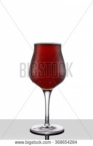 Red Ale Beer In Tulip Wineglass Isolated On White Background