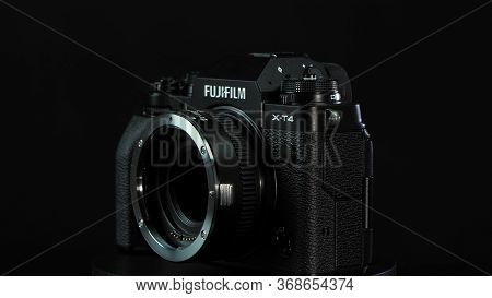 Tomsk, Russia - May 28, 2020: Fujifilm X-t4 Body With Fringer Ef-fx Proii Adapter Standing On A Blac