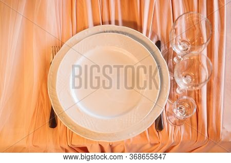 Top View Festive Table Setting With Empty Wine Glasses And Plate