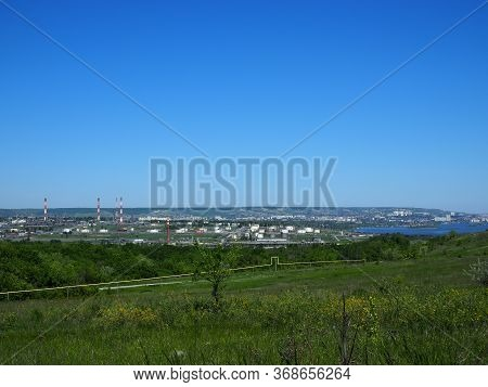 Oil Refinery And Petrochemical Architecture Plant Industrial With Blue Sky Background, White Oil And