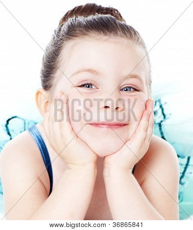 Young Ballerina Laying With Face In Hands