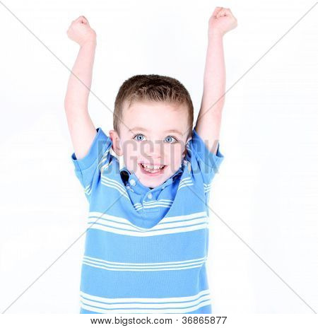 Little Boy With Arms Up In The Air Cheering