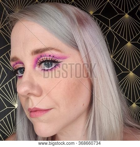1960s Makeup With A Cut Crease And Big Lashes
