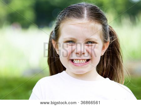 Young Girl Laughing In The Park