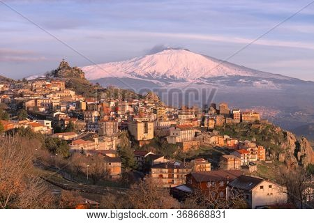 mountain village of Sicily and natural landmark Etna Mount snow covered