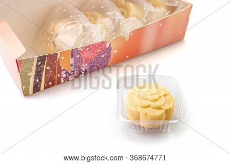 One Piece Of Delicious Pineapple Bread Near The Colorful Box On A White Background. Copy Space, Sele