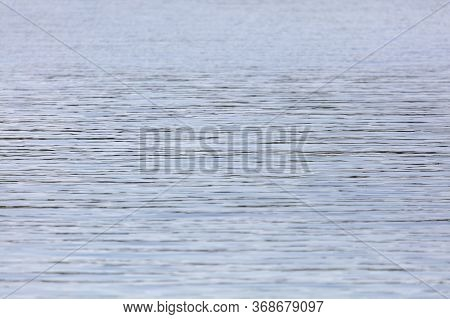 View Of A Calm Body Of Water With Wind Ripples On The Surface.