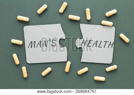 Inscription Man S Health On White Disconnected Puzzles, Yellow Pills On A Green Background