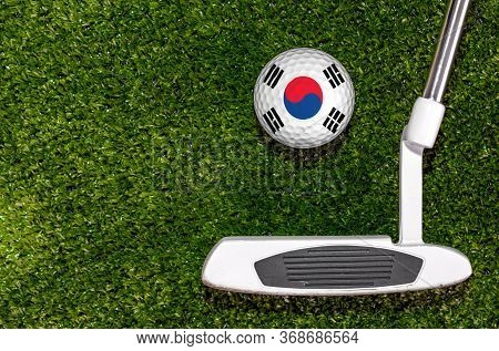 A Golf Club And A Ball With Flag South Korea During A Golf Game.