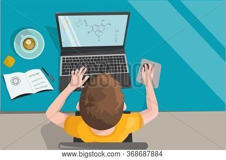 Remote Home-based Online Training. A Schoolboy With A Computer Sits At A Table In His House And List