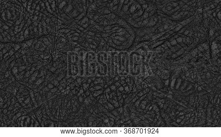 Seamless black leather texture. Dark leather surface close up.