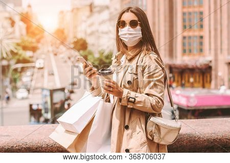 Happy Elegant Woman In Protective Face Mask With Shopping Bags On Sunny City Street. Beautiful Styli
