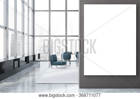 Interior Of Panoramic Dining Room With Grey Walls, Concrete Floor, Long Grey Table With Blue Armchai