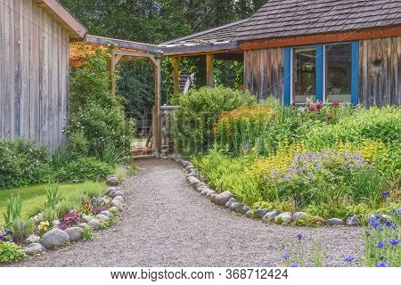 Keremeos, British Columbia/canada - June 3, 2017: Beautiful Garden Path At The Entrance To The Grist