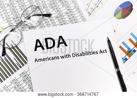 Ada Americans With Disabilities Act Concept. The Inscription On The Sheet. Pen, Glasses, Documents,