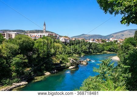 Scenic View From Mostar Bridge Of The Neretva River And Old City Of Mostar, Bosnia And Herzegovina