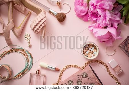 Fashion women stylish accessories outfit composition. Flat lay pink pastel background table with copy mock up space. Women clothing shopping sale concept. Top view overhead.