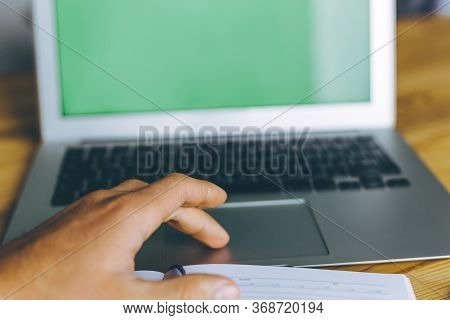 Business Person Using Touchpad Of Laptop With Green Screen.