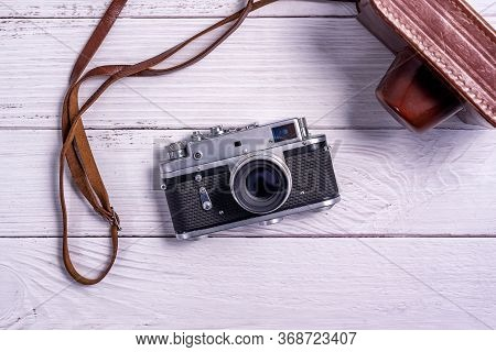 Vintage Rangefinder Film Camera With Leather Case On White Wooden Table. The View From The   Top. Ol