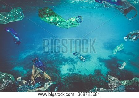 plastic waste, bottle bags floating underwater in the sea. no one around, concept of ecological disaster and problem in the disposal of plastic.