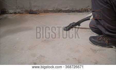 Cleaning Service. Dust Removal With Vacuum Cleaner. A Worker Removes Building Dust With A Vacuum Cle