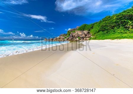 Peaceful Perfect Postcard Of Seychelles Beach In La Digue. The White Sandy Beach And Turquoise Sea O