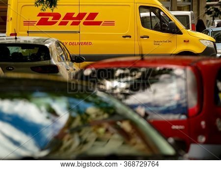 Bucharest, Romania - May 25, 2020 An Yellow Dhl Delivery Van Is Seen On A Street In Downtown Buchare