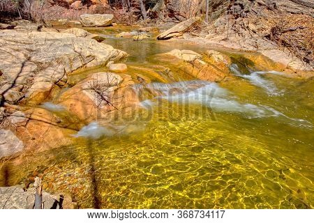 A Section Of West Fork Creek Where The Creek Bed Has A Golden Glow Due To The Way The Sun Reflects O