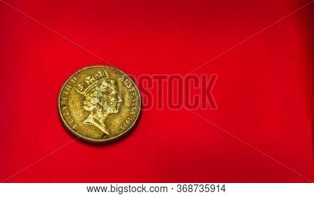 Australian Dollar Coin Back Side Isolated On Red Background With Soft Blurry And Space For Copy Text
