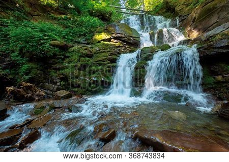 Waterfall In The Fores. Rapid Water Of Mountain River. Beautiful Nature Background. Calming Summer L