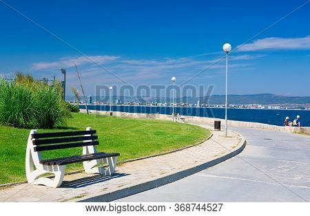 Bench On The Sea Embankment. Summer Vacation And Beach Relax Concept. Nessebar Beautiful Travel Dest