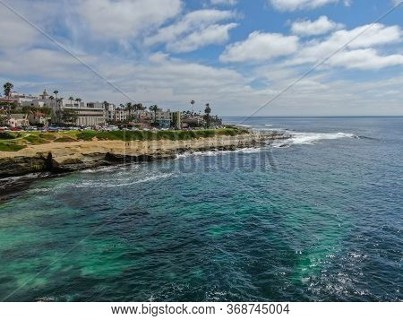 Aerial View Of La Jolla Coast, San Diego, California. Beach And Blue Sea With Small Waves. Hilly Sea