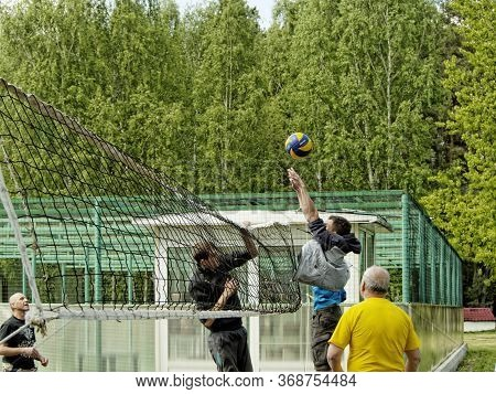 Moscow, Russia - May 22, 2017: Men Of Different Ages Playing Volleyball At Their Leisure In The Fore