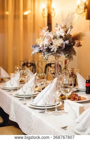 Festive Table Setting With Empty Wine Glasses