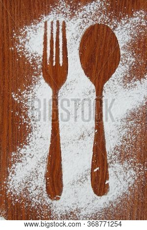 Fork And A Spoon Shadow. Fork And A Spoon Made Of Sugar Powder.