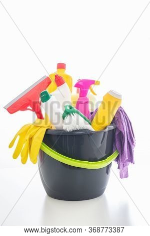 Cleaning Products Isolated Against White Background. Plastic Chemical Detergent Bottles And Equipmen