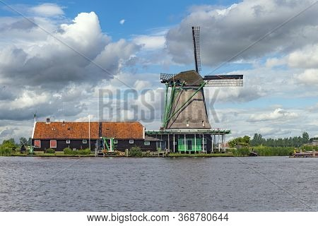 Dutch Sawmill At The Border Of The Lake Waiting For Tree Trunks Delivery, Zaanse Schans, Netherlands