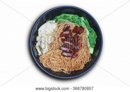 Traditional Chinese Wantan Mee Noodle  Served With Char Siew Braised Pork And Cabbage On Dark Wooden