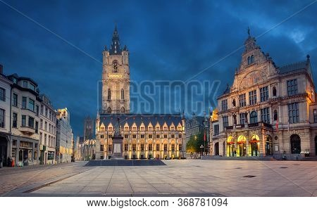 Ghent, Belgium. Sint-baafsplein Square At Dusk With Building Of Historic Town Hall And Famous Belfry