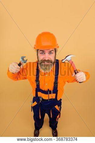 Bearded Builder. Hammer. Adjustable Wrench. Builder In Construction Helmet. Repairment Tools. Indust