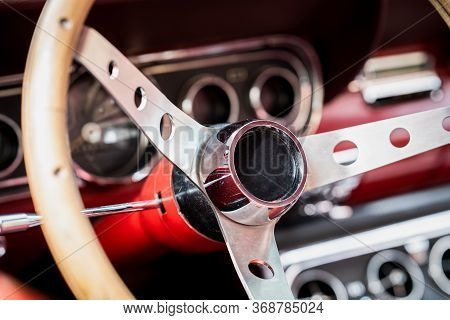 Retro Interior Of Old Automobile, Steering Wheel And Dashboard In Historic Vintage Red Car. Old Vehi