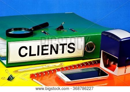 Clients-text Label On The Registrar's Folder. Planning Brand Promotion, Increasing Sales, Attracting