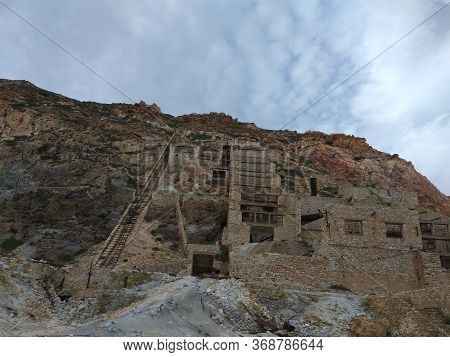 Destroyed Sulfur Factory In The Mountains. Broken Brick Buildings With Stairs. Greece. Milos Island.