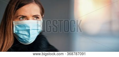 Young Woman Wearing Disposable Blue Virus Face Mouth Nose Mask, Closeup Portrait, Banner With Space